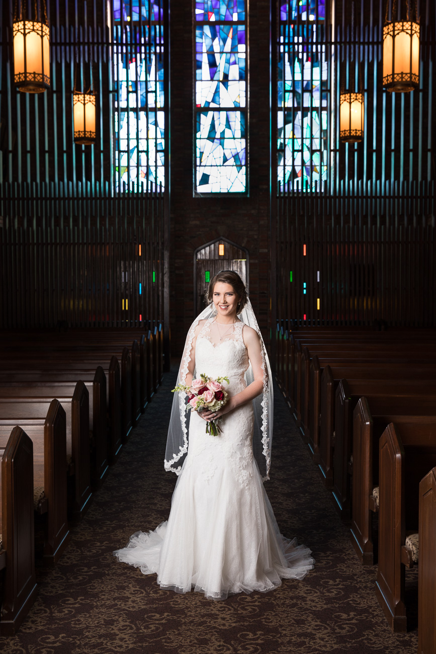 The stained glass windows inside the Chapel of Memories are a work of art. I love taking bridal portraits here!