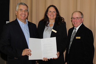 From left: Representative David Reis (R-109) presents Norris Electric Cooperative Manager Tamara Phillips and Board President Gordon McClure with an Illinois House of Representatives resolution congratulating members on the 80th anniversary of their cooperative.