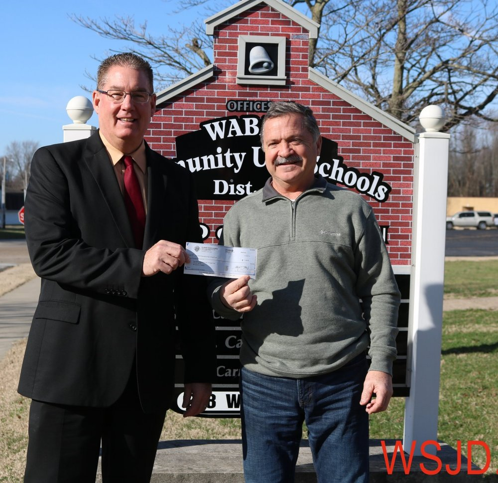 District #348 Superintendent Tim Buss accepts a $1,000 check from Dan Kieffer of the Mt. Carmel K of C.