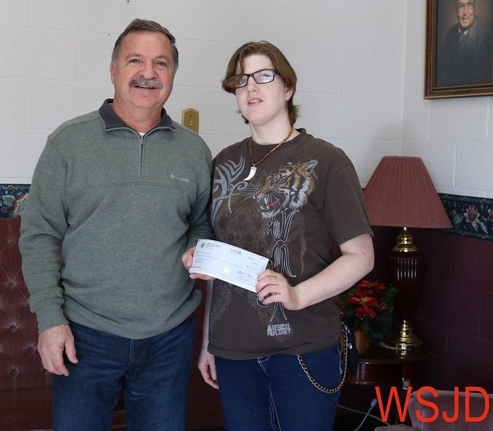 Dan Kieffer presents a $1,000 check to WAVE's Misty Holstlaw.