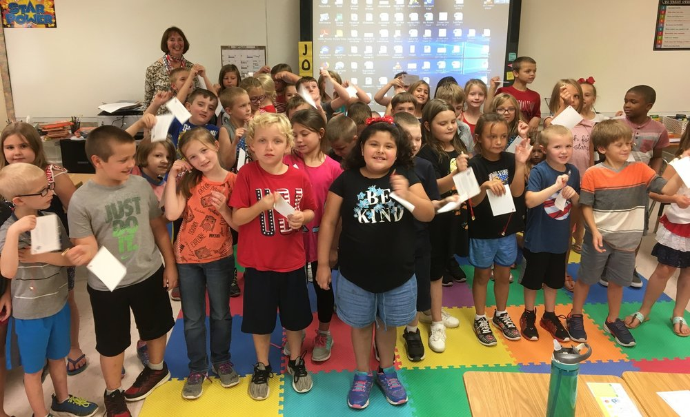 "Students at MCES celebrated Constitution Day on September 17th.  The students in Mrs. Jones/Ms. Bruce classes listened to Susan Woods from the DAR read the book ""We the Kids"", learned a song called ""We the People"" and rang small bells together as a group - signifying the Constitutional Rights we have as United States Citizens."