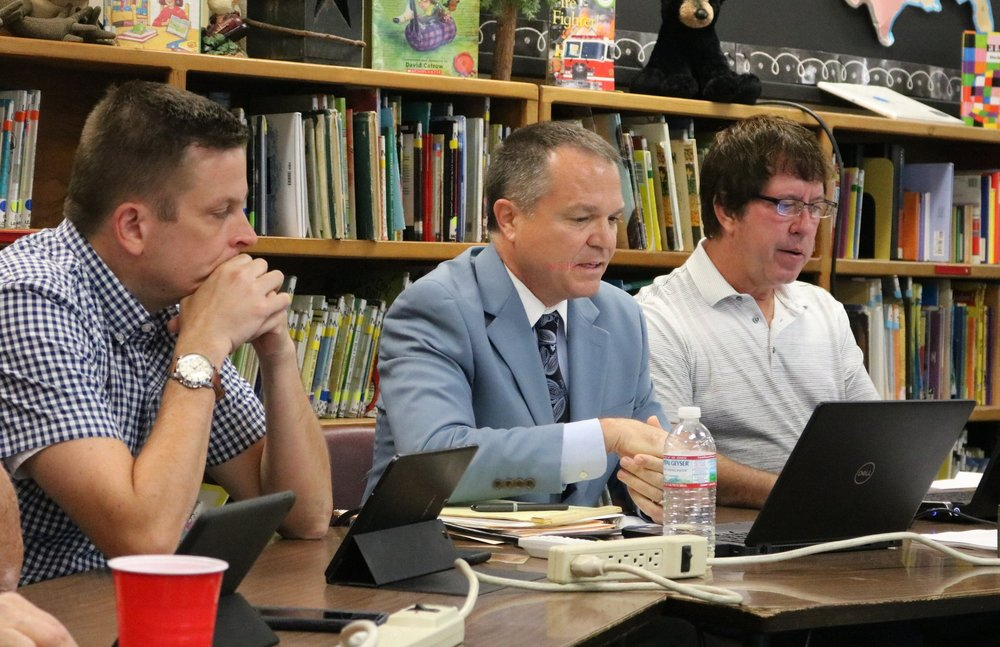 District #348 Superintendent Dr. Chuck Bleyer (Center) outlines the 2018-19 budget as board member Kyle Peach (L) and board president Tim Schuler (R) look on.