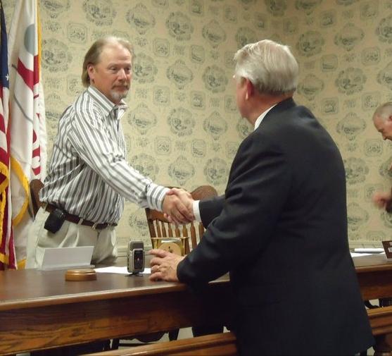 WSJD File Photo: 2011-Mayor Tom Meeks shakes hands with Mayor-elect Bill Hudson at Meeks' last meeting as mayor.