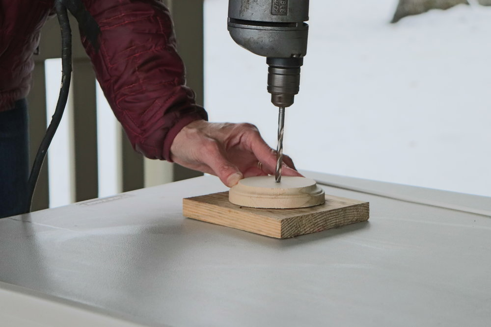 Use a block of wood under the base, to protect your table (just in case)