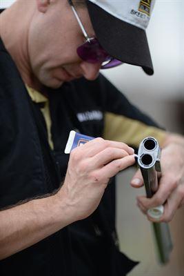Carl Wojtaszek does gun maintenance.JPG