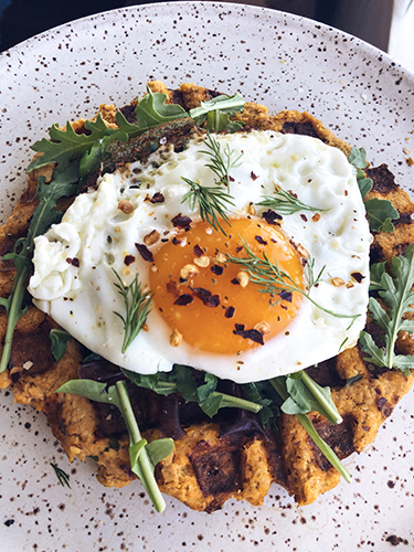 I turned the salmon cake recipes from the whole30 book into a waffle and topped it with arugula, a fried egg, dill, salt, pepper and chili flakes. It was delicious and super filling.