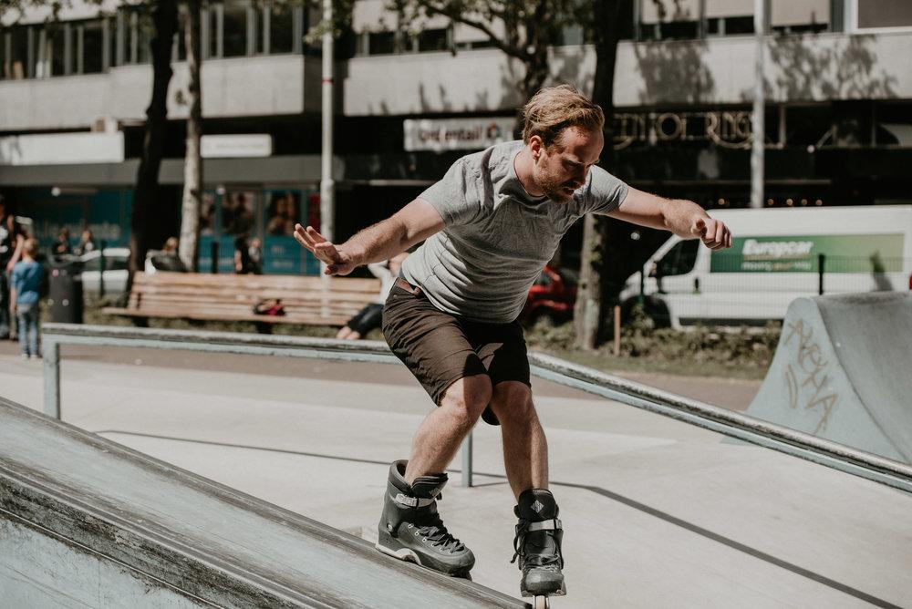 Man in rollerblades at the westblaak skatepark doing tricks. Rotterdam urban photo race