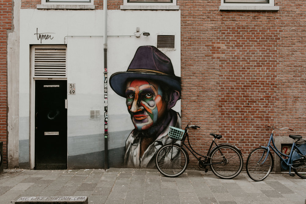 Freddy Krurger spray painted in Rotterdam on witte de withstraat with two bikes on the side.