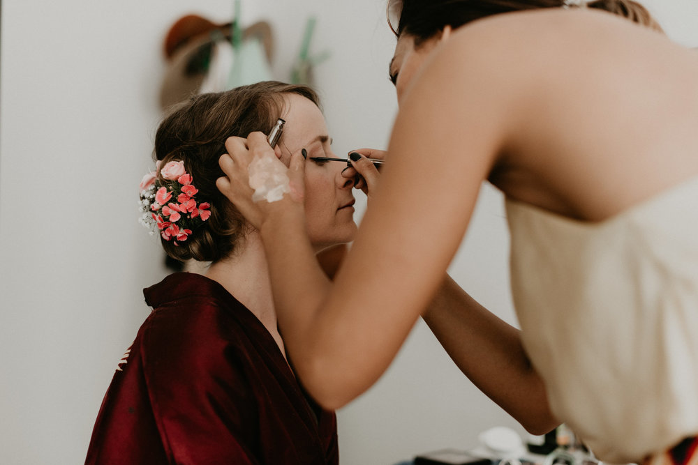 Rotterdam Bride getting her makeup done in a red robe