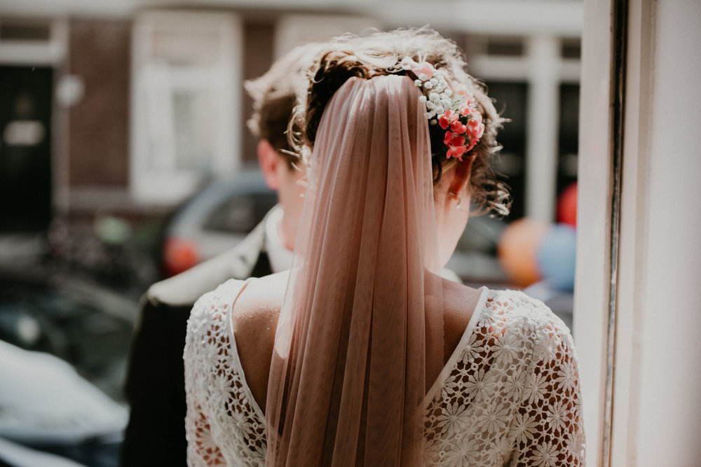 Rotterdam bride walking out the front door to see her husband for the first time