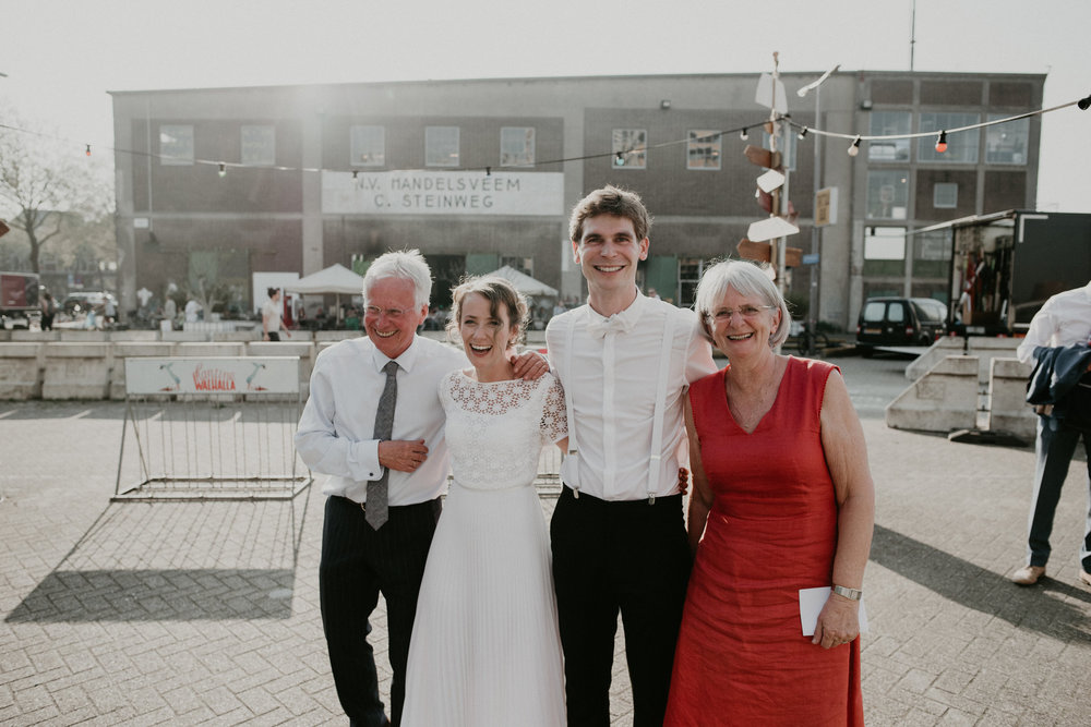 Bride and groom standing with her parents at de Walhalla in rotterdam Nederland