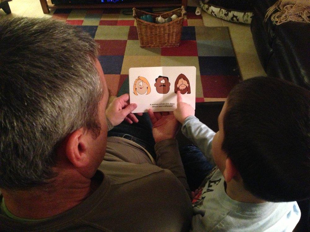 Steve and Levi reading Jesus Cat.JPG