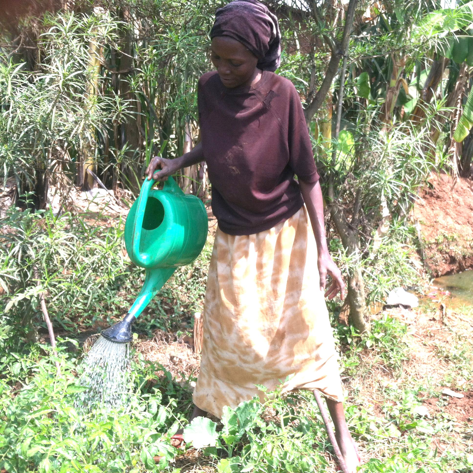 Edith watering her garden