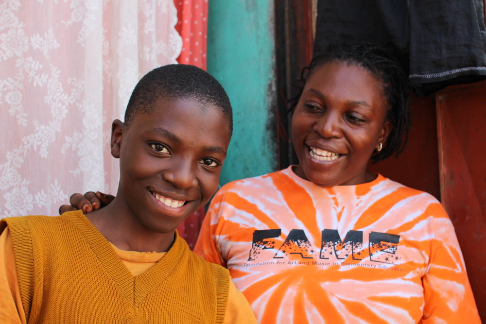 'With gods help I'll make my children's dreams will come true.' Hajara with her son
