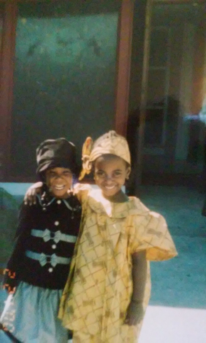 Me on the right, aged five, outside of Kingdom Covenant Ministries