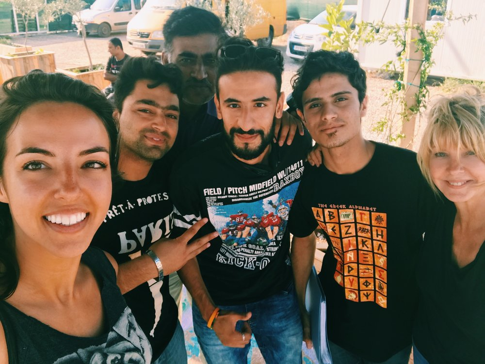 Megan Majd, with the first users of Harmoni App in Oinofyta Camp in Athens, Greece.