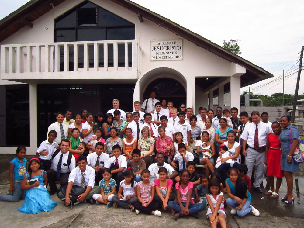 Outside the church house in El Coca with our mission president and the members of the branch.