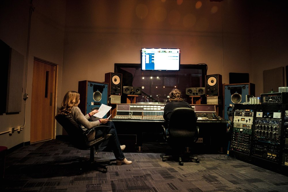 Michelle Soderberg working with Marc Golde, producer of Rock Garden Studio in Appleton, Wis.