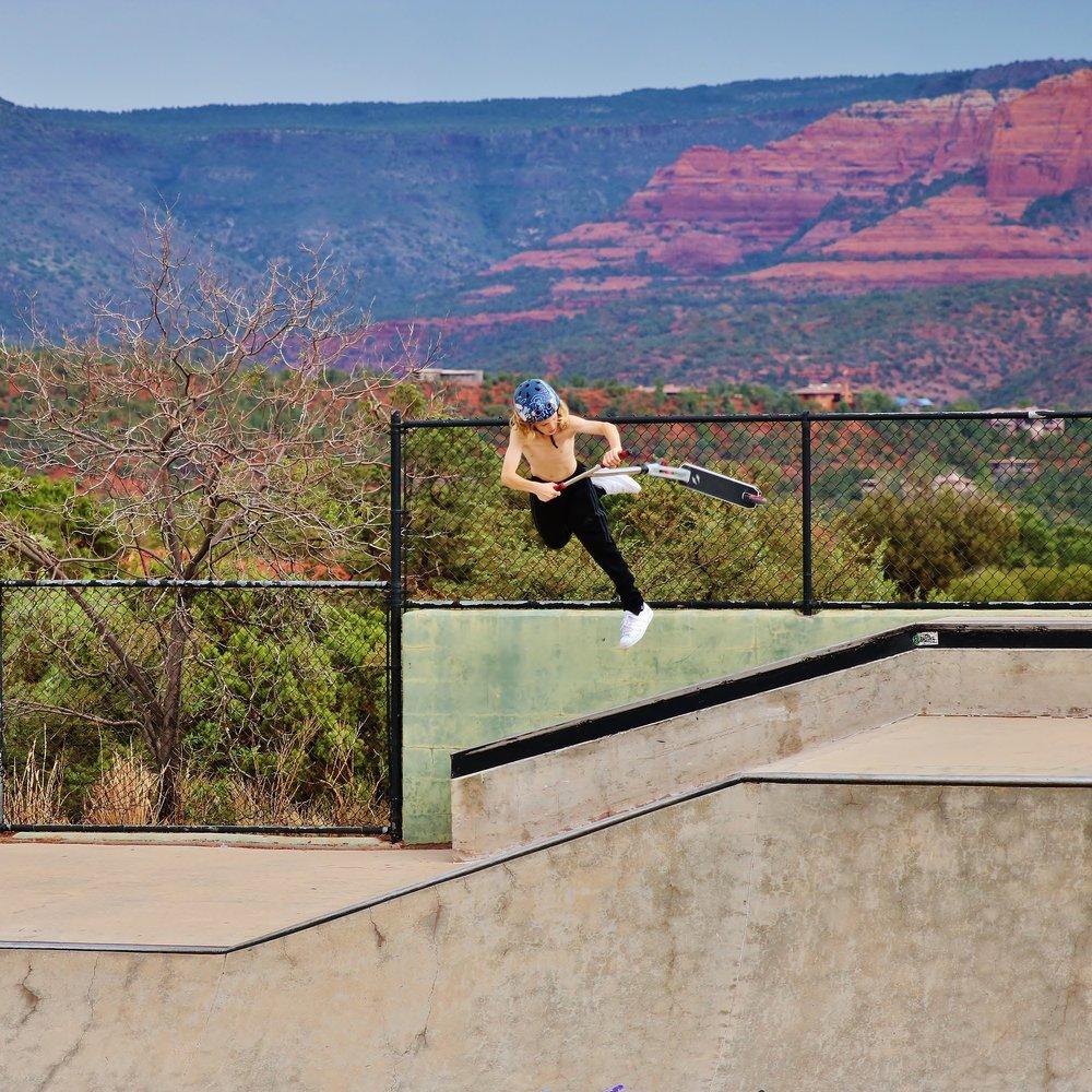 Havoc & S1 Pro Rider, just 13 years -old, Daniel Deeder, flying high against the scenic backdrop of Sedona Skatepark in Arizona.