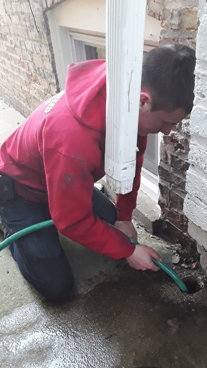 Gutter+Cleaning+Chicago-+Downspout+Drain+Cleaning.jpg