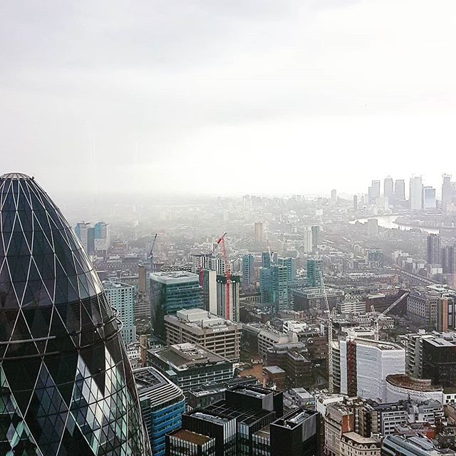 What a view! (Even with some typical British weather!) #thecheesegrater #bco #rogerstirkharbour #amazingarchitecture #londonskyline #officeinteriors #workplacedesign #interiordesign #londonofficedesign #topfloorview #britishweather #makingworklive