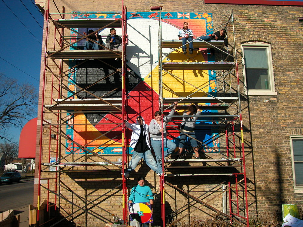 Mural in progress on South exterior wall of the Nawayee School in the Phillips neighborhood, Minneapolis, Minnesota
