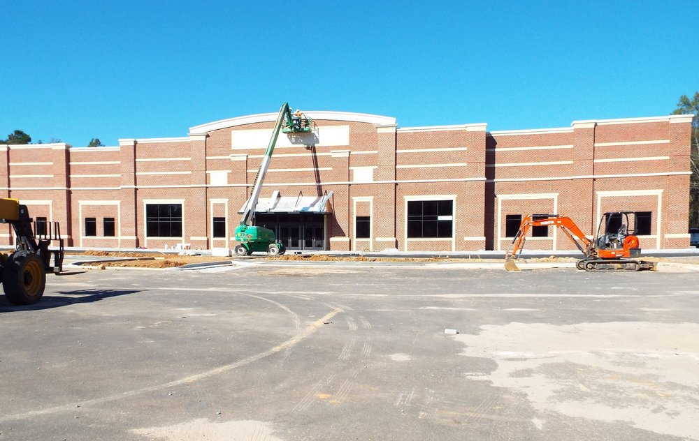 The Exterior facade of the new gym emphasizing a merging of old and new with the date of the old Buford gym of 1951 and our new gym of 2017.  Photo Credit: Alicia Couch Payne