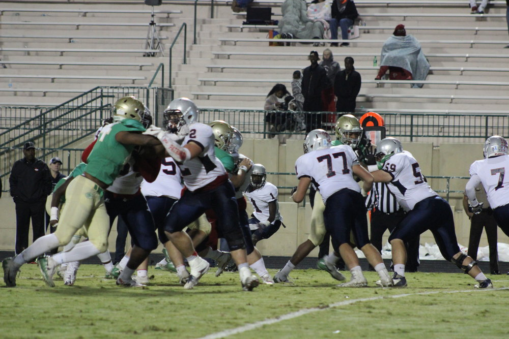 Wolves shutting down the Patriots' running game.Photo credits Alicia Couch Payne