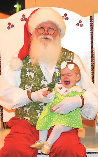 One of Sugar Hill's smallest residents is not so happy to meet Santa for the first time. Photo Credit: David Grffin