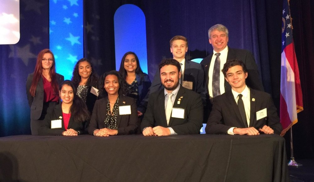Back row, left to right: Laura Ann Acker, Camryn Flores, Bhaumi Shah, Camden Doker, Mike Sullivan.  Front Row, left to right: Nida Merchant, Spencer Grace Williams, Kaan Cubukcu, Ethan Shaw     Photo courtesy Camryn Flores