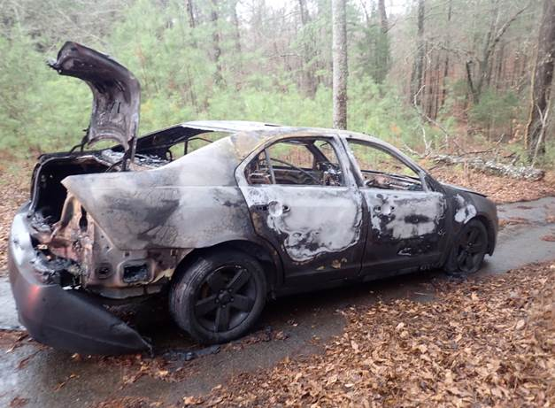 What's left of a car stolen from Suwanee and set on fire in Auburn. Photo courtesy Gwinnett County FD