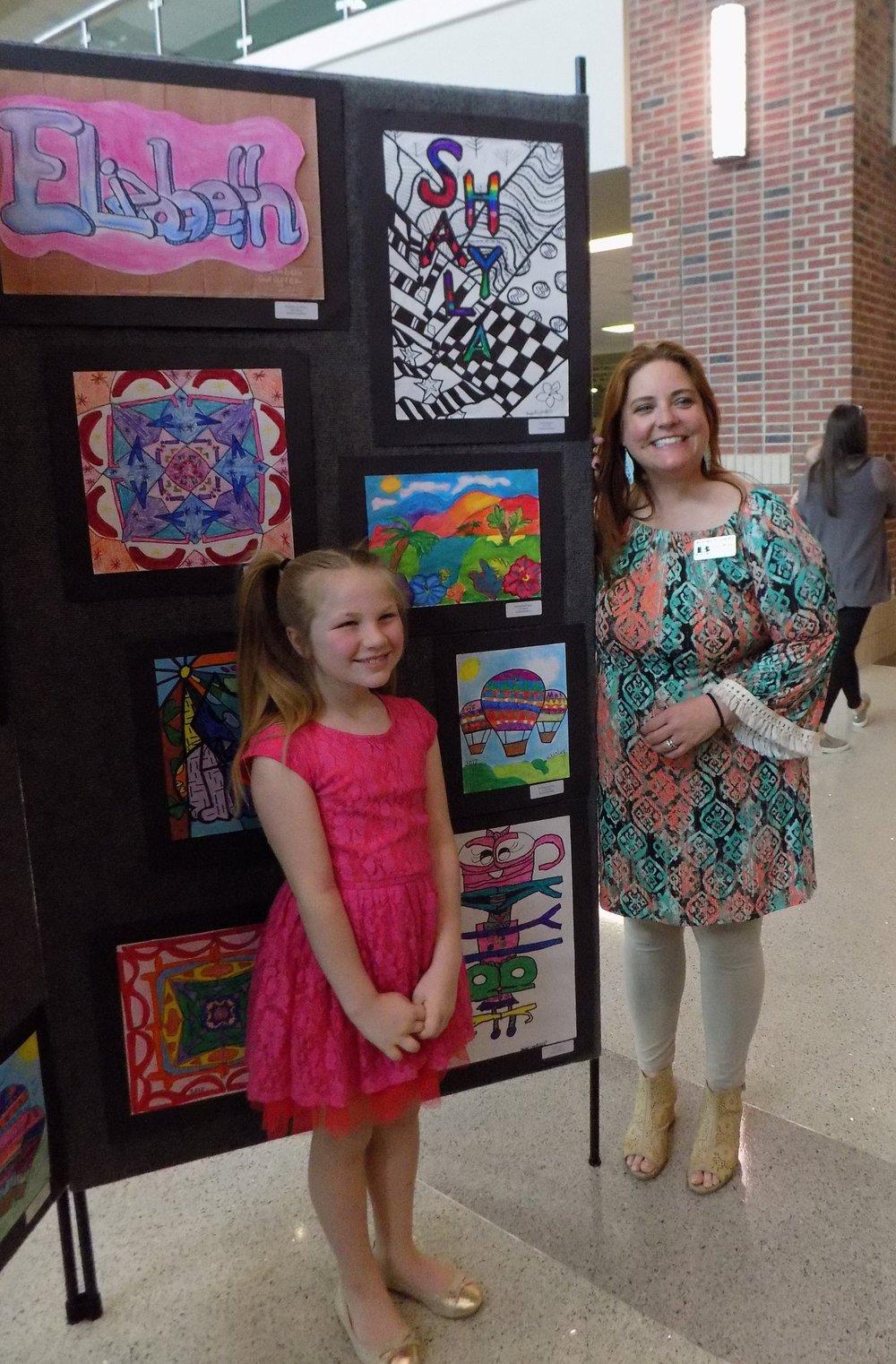 Second grader McKinley LaSpisa with Academy Art Teacher, Mrs. Ashley Wright with McKinley's Hot Air Balloons. Photo courtesy Jennifer Elskamp