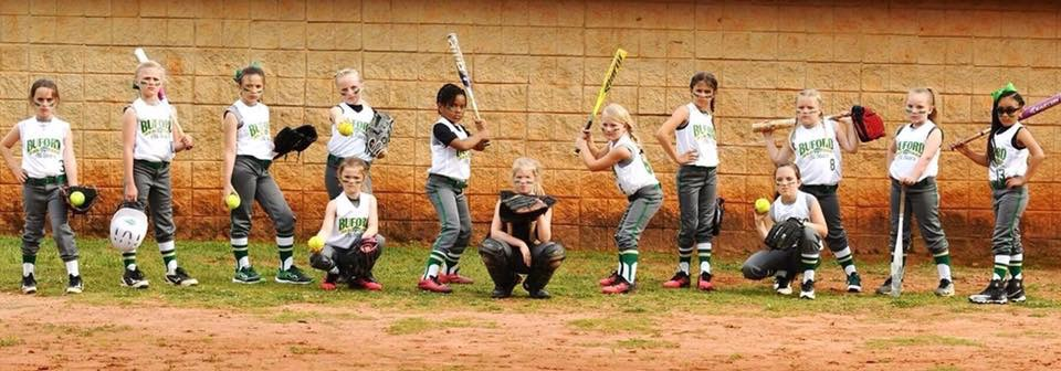 The Green 8U Lady Wolves All-Stars coached by Stephen Fountain. Photo courtesy of Felicia Waycaster