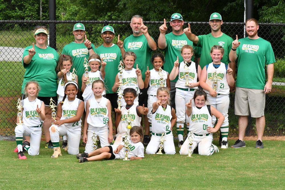 The White 8U Lady Wolves All-Stars coached by Joel Parent. Photo credit: Megan Weaver
