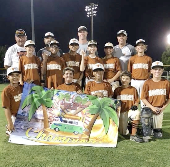 The 11U Lanier Longhorns Travel Baseball Team left Orange Beach, AL with the USSSA World Series Championship title. Photo courtesy Carrie Laughlin.