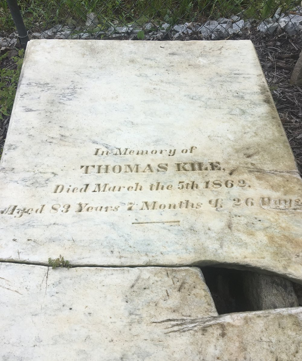 The cracked marker for Thomas Kile who was part of the Gwinnett Militia is also part of the Kile-Benson family cemetery. Photo courtesy Brandon Hembree