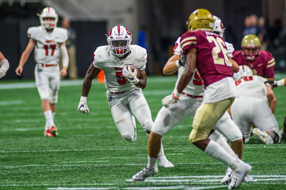 North's star running back Tyler Goodson keeps an eye on Brookwood's defense as he heads for the end zone. Photo credit: Nicole Seitz