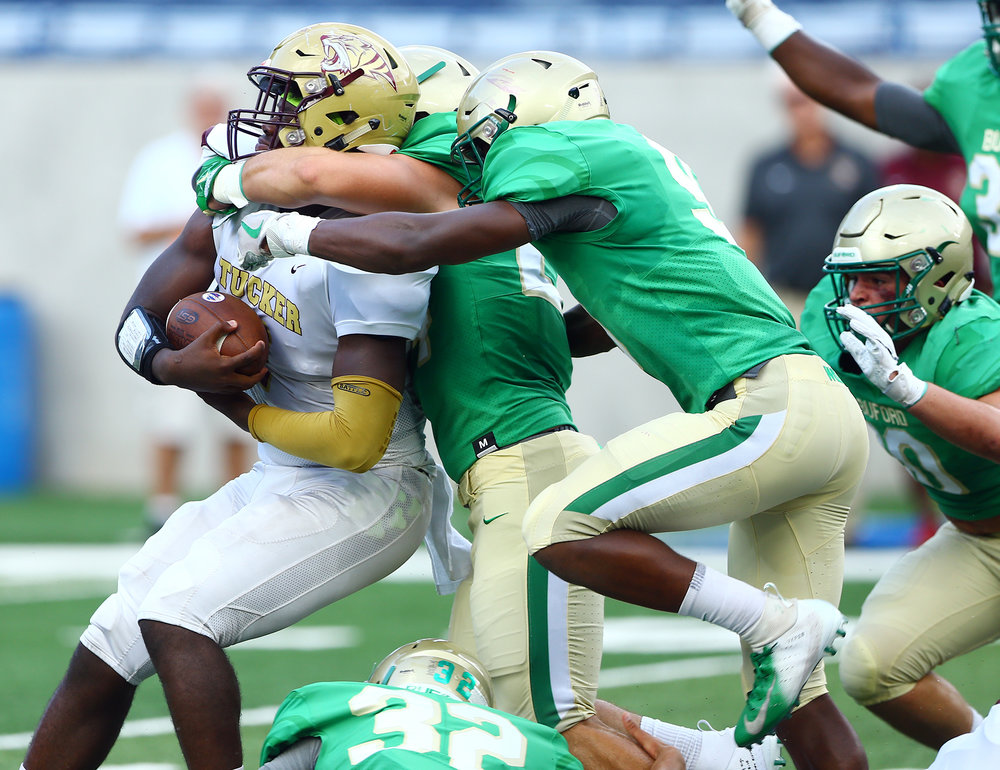 Buford's Jackson Powell and defensive line teammates keep Tucker's ability to score limited on Friday night.  Photo credit: David McGregor