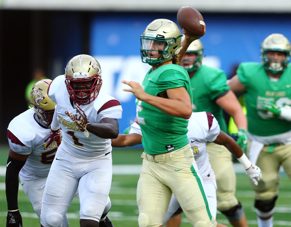 Buford QB Aaron McLaughlin looks for a receiver down field.  Photo credit:  David McGregor