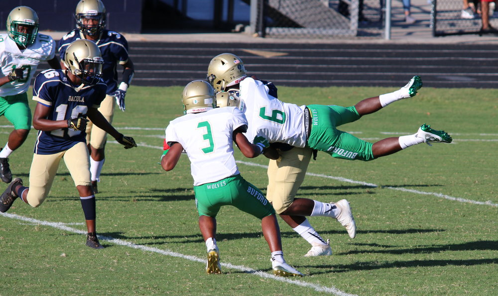 Buford's Victor Venn goes airborne to stop Dacula's play during the game. Photo credit: Natasha Zagradnick.