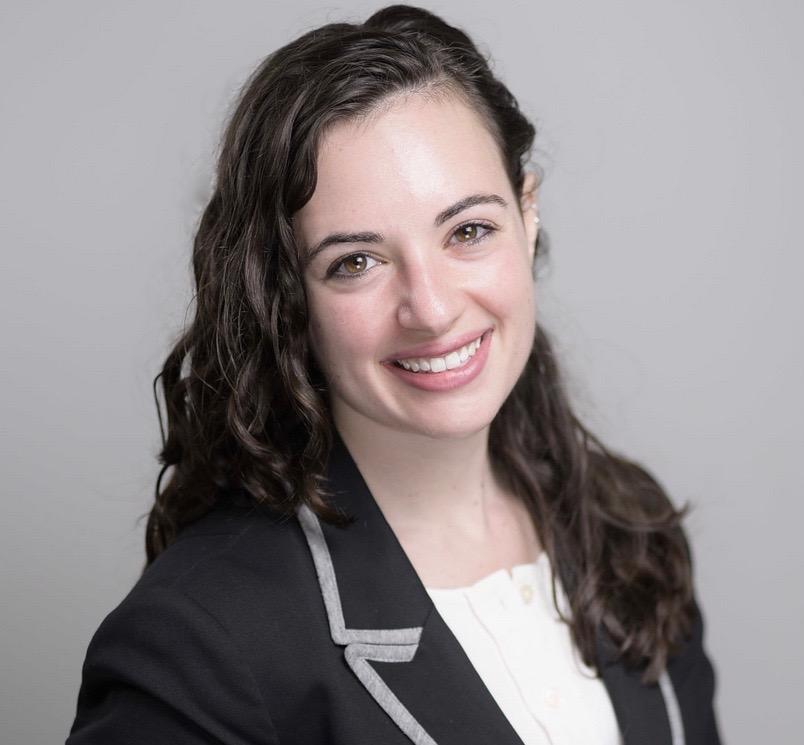 Headshot photo of C.O.O, Elizabeth Petitti, smiling