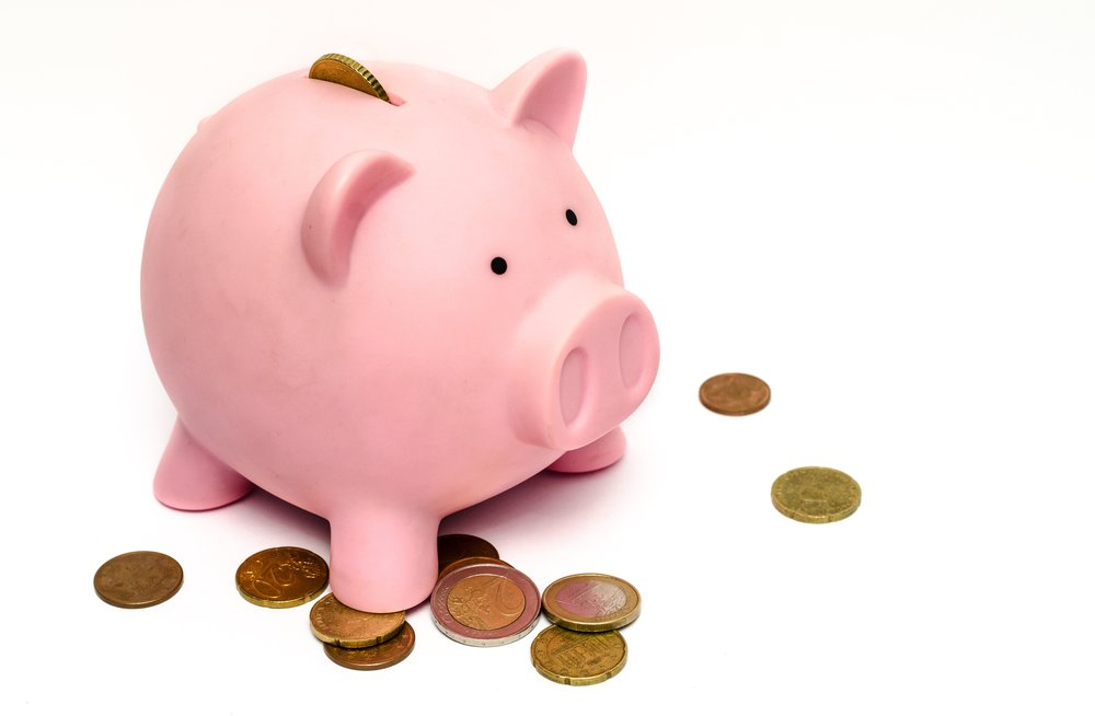 Piggy bank with coins outside