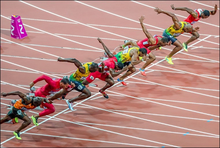 Bolt (third from left) sets off to win the 100m at the London 2012 Olympics. Photo by Nick Moulds.