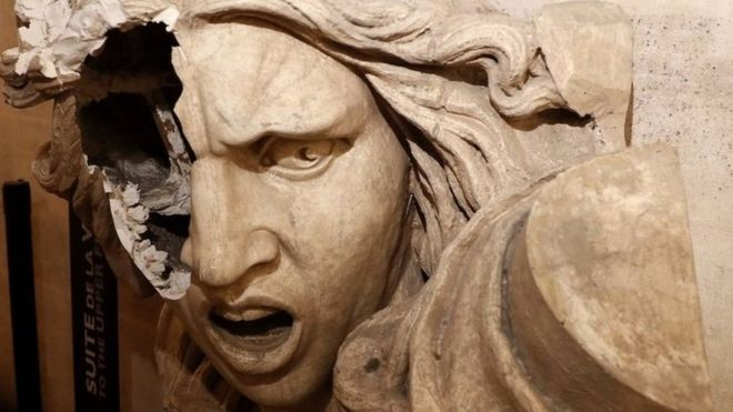 A statue of Marianne, vandalised inside the Arc de Triomphe in protest