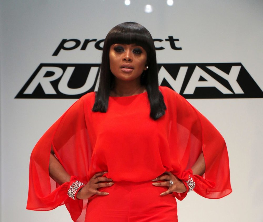 """BRIEF EXCERPT COURTESY OF ELLE SA:      """"As Project Runway SA's host, Kganyago will be leading South African audiences through the adventures, dramas and stories as they unfold onscreen; she's the one who will be heading Noni Gasa and Rahim Rawjee as the panel of expert judges; and while she's the one who will be eliminating contestants at the end of each episode, she's also the one who will be nurturing their talent alongside Project Runway SA's mentor Gert-Johan Coetzee.      """"I am going to be encouraging the designers to cut out the noise and to follow their inner voice"""", says Kganyago.      Whether she's in the boardroom or on stage in power suits, ball gowns, or a pair of jeans and a t-shirt, Kganyago has always seen fashion as a canvas for the people.      """"We live in a very visual time, and the clothes we choose to wear – and how we put them together – become a billboard of who we really are."""""""