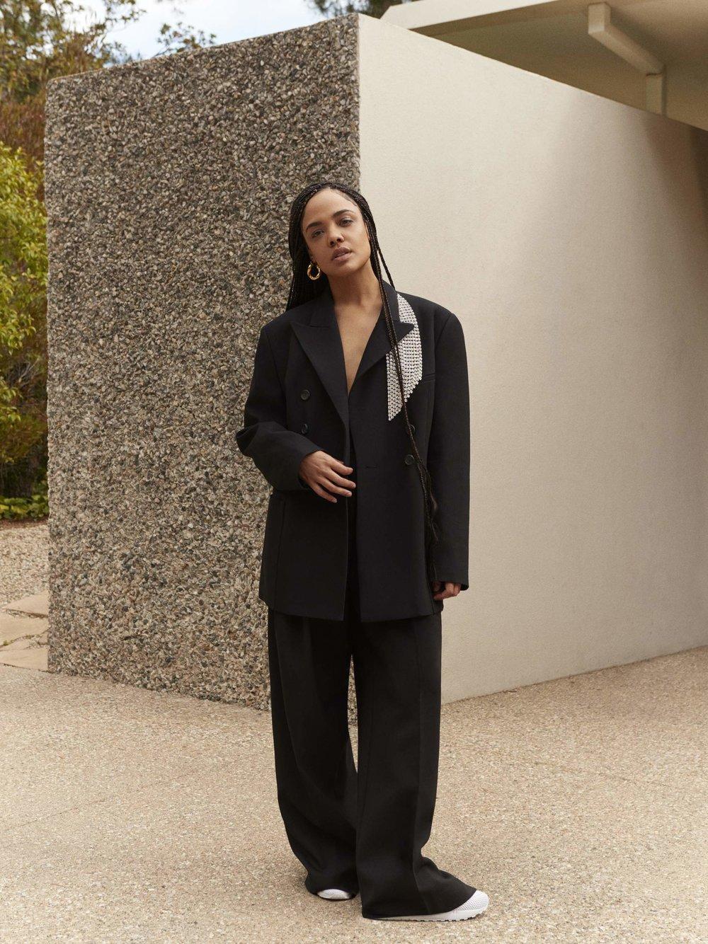- Blazer Christopher Kane; pants JW Anderson; sneakers Nike; earring (sold as pair) Laura Lombardi
