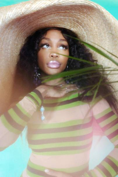 SZA - Hat by Jacquemus, dress by Norma Kamali, shoes by Giuseppe Zanotti and earrings by Calvin Klein. Photography by Elizabeth Wirija. Hair by Randy Stodghill using Oribe. Styling by Dianne Garcia.
