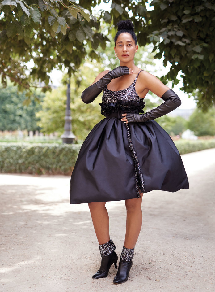 - Chanel Haute Couture dress, fingerless gloves, and ankle boots. Agmes earring.