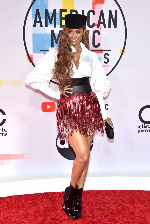 - Tyra Banks in Gucci, Carolina Constas with a Tadashi Shoji bag