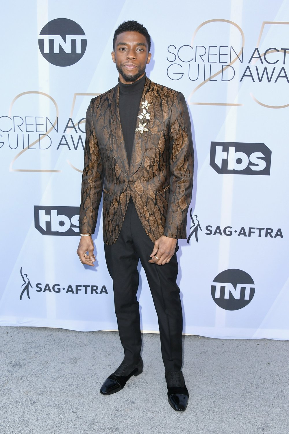 - Chadwick Boseman in Ermenegildo Zegna XXX, Christian Louboutin shoes, and Tiffany & Co. jewelry